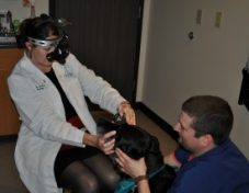 """Jonas"", a seeing-eye-dog, receives his ophthalmic screening exam as part of the ACVO/StokesRx event in May"
